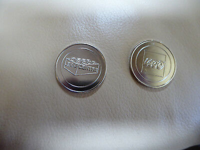 2 Metal Tokens from LegoCentre. LEGO on one side.