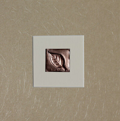 Hand burnish copper bas-relief mix media leaf with lite brown on Cream backing