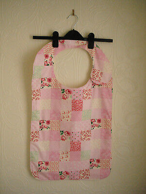 Adult Bib in a Pink Flowery Material