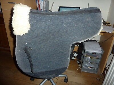 Black cotton med/large horse numnah with sheepskin lining in good condition
