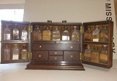 antique Apothecary portable cabinet with all the extras must see
