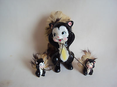 Vintage Pottery Skunk Figurines Family Set