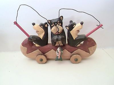 Carved wooden 3 bears fishing
