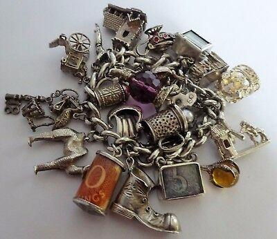 Amazing heavy vintage solid silver charm bracelet & rare silver charms. 121.7g