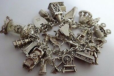 Superb heavy vintage solid silver charm bracelet & 24 silver charms, 1968. 77.8g