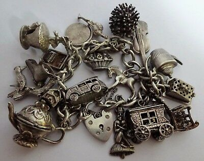 Lovely vintage solid silver charm bracelet & 18 interesting silver charms, 1974