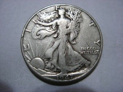 Very nice better date 1947-D Walking Liberty half in F condition.