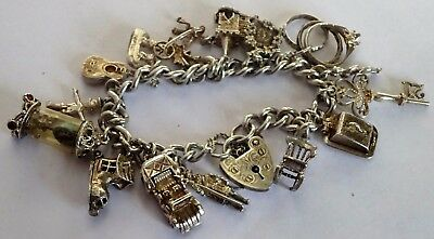 Gorgeous vintage solid silver charm bracelet & 16 lovely charms. 1960