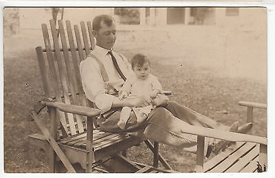 RPPC - Man & Child sitting on custom-made lawn furniture - early 1900s