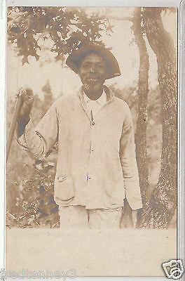 RPPC - Black man working on farm - early 1900s