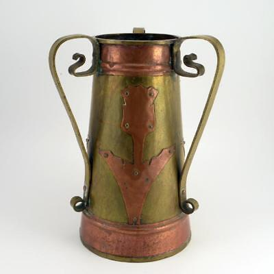 A Russian Arts and Crafts Three-Handled Brass And Copper Vase