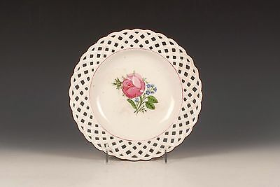 A Russian Gardner Porcelain Works reticulated floral plate, early 19th century