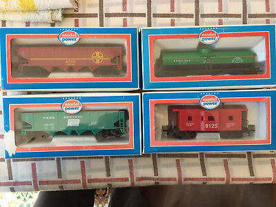 3 x HO Freight Cars & 1 Caboose by Model Power