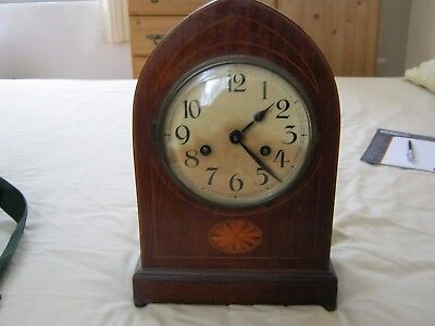 old small clock, keeps good time, but dial is stained. Strikes the hour and half