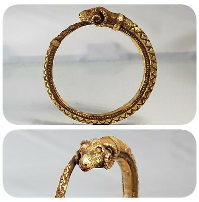 Stunning ancient Greek solid gold rams head bracelet, hellenistic period