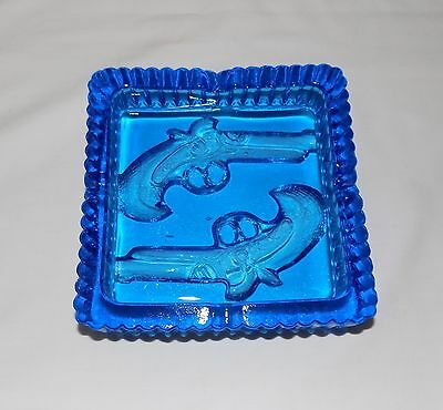 "VINTAGE THICK BLUE GLASS ASHTRAY WITH 2 PISTOLS GUNS 6"" x 6"" x 1 1/2"""