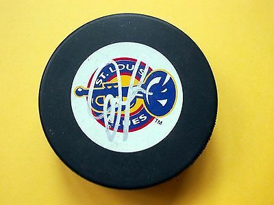 JAMIE McLENNAN, ST. LOUIS BLUES/GUILDFORD FLAMES, AUTO'D PUCK WITH HOLDER.