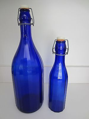 Two Collectible Cobalt Blue Glass Wine Bottles With Wired Lids  & Corks