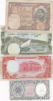 Seven North African Banknotes In A Used To Near Mint Condition