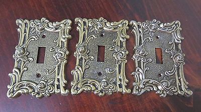 Antique 1967 American Tack & Hardware cast bronze switch plates with rose design