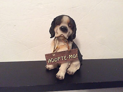 """Black and White Dog Figurine, Sitting, with sign """"Adopte-Moi"""", Resin, 5"""""""
