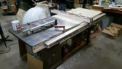 """Delta 10"""" Unisaw Table Saw, 2HP, 1PH, 52"""" Biesemeyer Fence with hanging cabinet."""