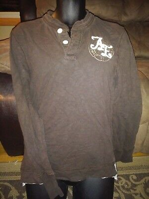 Mens size SMALL, vintage fit American Eagle, brown and white colored sweater