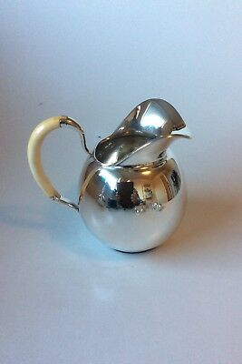 F. Hingelberg Sterling Silver Water Pitcher by Svend Weihrauch with bone handle.