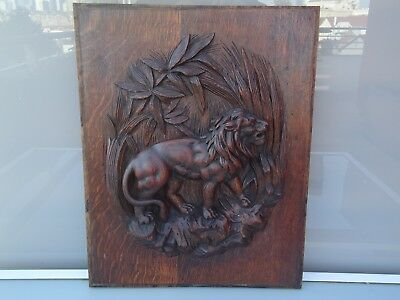 Antique french wood door panel carved with lion animal savane