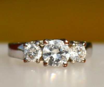Three round clear CZ stones silver tone   RING size 5.5  band have some wear