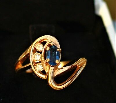 Faux navy blue sapphite - CZ stone with clear gold tone  RING size 8.5