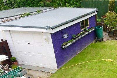 Large Concrete Sectional Garage with roof door security light