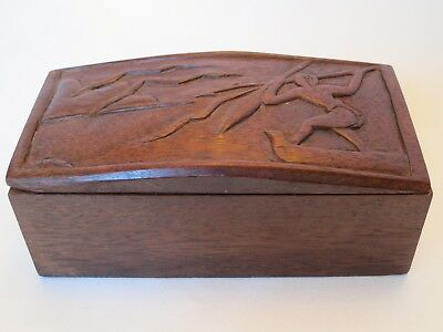 Rose wood box. Hand carved led. Carving of fisherman with spear on a lake