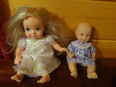 lot of two pretty baby & Disney Princess girl dolls with clothing