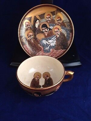 Antique Meiji period Japanese Satsuma A Thousand Faces pottery cup and saucer