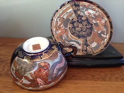Antique Meiji Japanese Satsuma A Thousand Faces & dragon pottery cup and saucer