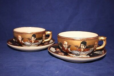 Two antique Meiji period Japanese Satsuma A Thousand Faces pottery cups+ saucers