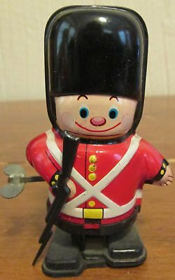 Vintage YONE Made in Japan Wind Up Tin Litho Toy Soldier Walking Guardsman