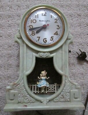 MASTERCRAFTERS SWINGING GIRL MOTION GREEN MARBLE CLOCK  AS-IS - REPAIR or PARTS