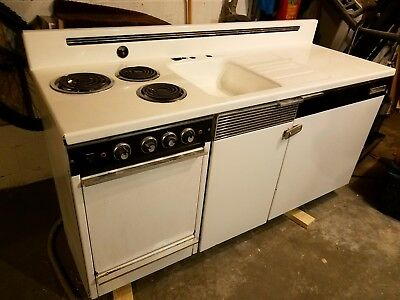 Kitchenette 6' wide. Complete Kitchen. Sink. Stove top. Oven. Refrigerator.
