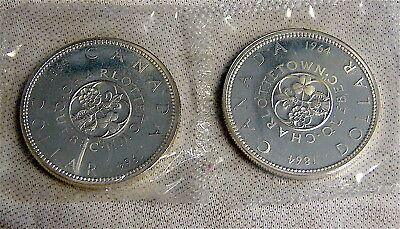 Canada Silver Dollars----2 dated 1964 Silver Dollars----Uncirculated .800 silver