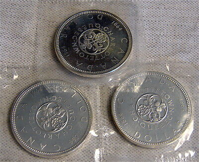 Canada Silver Dollars----3 dated 1964 Silver Dollars----Uncirculated .800 silver