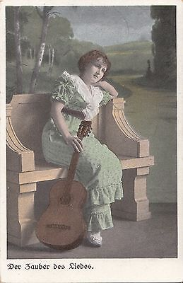 CG100.Vintage German Postcard.Lady with guitar. The Magic of the Song.