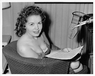 Busty girl giving a radio broadcast - vintage risque 40s pinup photo