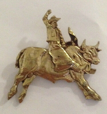 Vintage Sculpted Rodeo Cowboy Riding the Bull B old metal badge