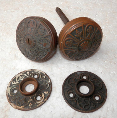 antique set of fancy cast brass doorknobs and rosettes on shaft ready to go circ