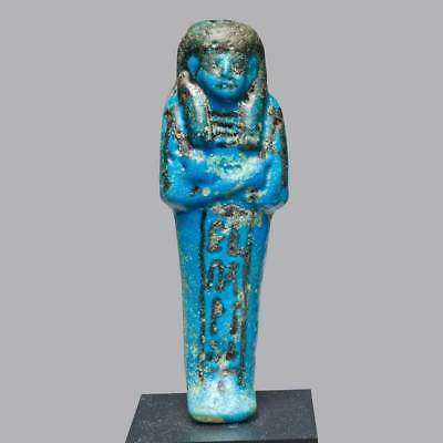* An Egyptian Faience Ushabti for Netchery, New Kingdom, 19th Dynasty, ca. 1295