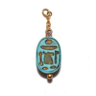 * A rare Egyptian Royal Glass Scarab for Ahmose I, beginning of 18th Dynasty, c.