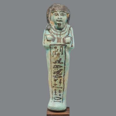 * An Egyptian Faience Shabti for chief director of the craftsmen, 19th Dynasty,