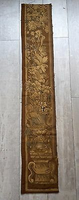 An Antique Tapestry Border with Vase and Flowers.